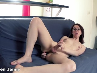 tgirl Jenissen plays on her couch until orgasm